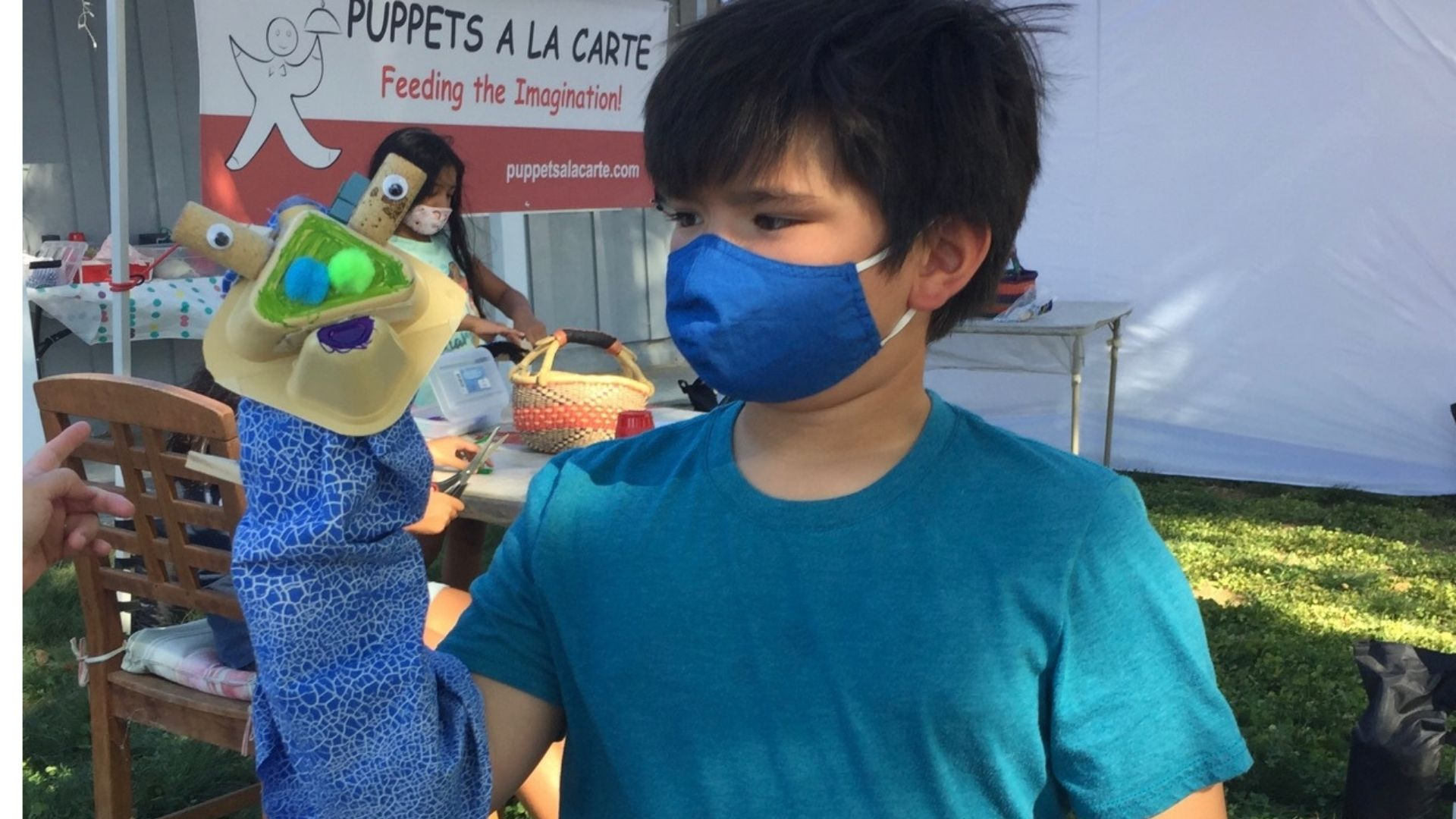 Child using puppet to express his imagination
